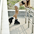 Stock Photo: Girl roller-skating in street