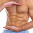 Closeup on male athlete showing great abdominal muscles — Stock Photo