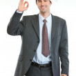 Smiling businessman in Santa's hat showing ok gesture — Stock Photo