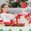 Closeup on table with Christmas decorations and female laying on — Stock Photo #12444477
