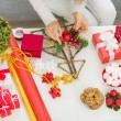 Closeup on table where woman making Christmas decorations. Upper — Stock Photo