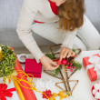 Closeup on table where female making Christmas decorations. Uppe — Stock Photo
