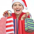 Royalty-Free Stock Photo: Happy woman in Christmas hat with shopping bags