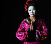 Portrait of geisha with hands together respect gesture isolated — Stock Photo