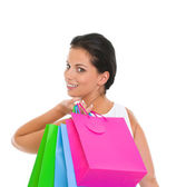 Portrait of smiling girl with shopping bags — Stock Photo