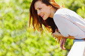Smiling woman looking on copyspace on spring day — Stock Photo
