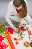 Closeup on table where female making Christmas decorations. Uppe — Photo