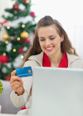 Happy young woman making Christmas shopping on internet — Stock Photo