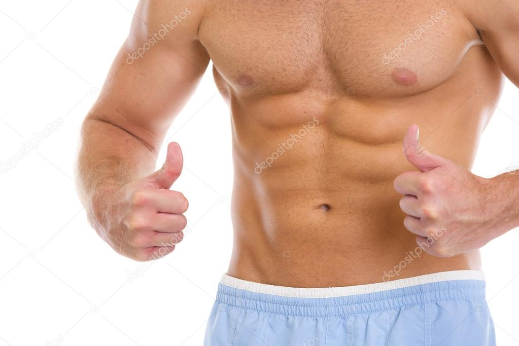 Closeup on man with abdominal muscles showing thumbs up — Stock Photo #12442697