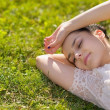 Young woman relaxing on grass — Stock Photo #13725599