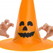 Halloween hat and scaring hand — Stock Photo