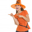 Happy young woman in Halloween hat pointing side — Stock Photo