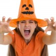Woman in Halloween hat making scaring pose — Stock Photo