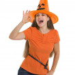 Happy young woman in Halloween hat showing ok gesture — Stock Photo #13728333