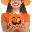 Closeup on Halloween bucket with sweets in woman hands — Stock Photo