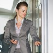 Business woman in elevator pushing button — Stock Photo