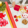 Closeup on female hand preparing Christmas gift — Stock Photo