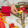 Stock Photo: Closeup on female hand making Christmas decorations