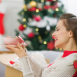 Happy young woman received parcel with Christmas gift — Stock Photo