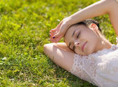 Young woman relaxing on grass — Stock Photo