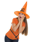 Scared young woman in Halloween hat looking on copy space — Stock Photo
