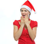 Portrait of surprised young woman in Santa hat — Stock Photo