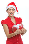 Happy young woman in Santa hat with Christmas present box — Stock Photo