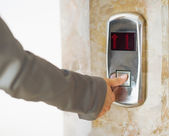 Closeup on business woman hand pushing elevator button — Stock Photo