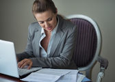 Business woman working with documents and laptop — Stock Photo