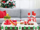 Table with Christmas decorations — Stock Photo