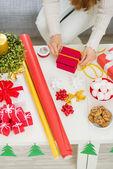 Closeup on female hand preparing Christmas gift — Stock Photo