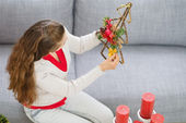 Woman making Christmas decorations — Stock Photo