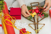 Closeup on female hand making Christmas decorations — Stock Photo