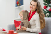 Mother and baby spending Christmas time together — Stock Photo