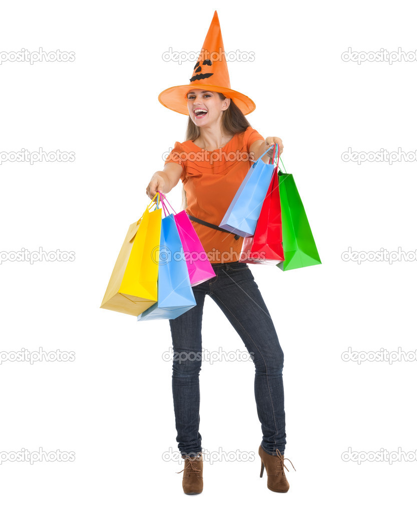Smiling woman in Halloween hat with shopping bags — Stock Photo #13728362