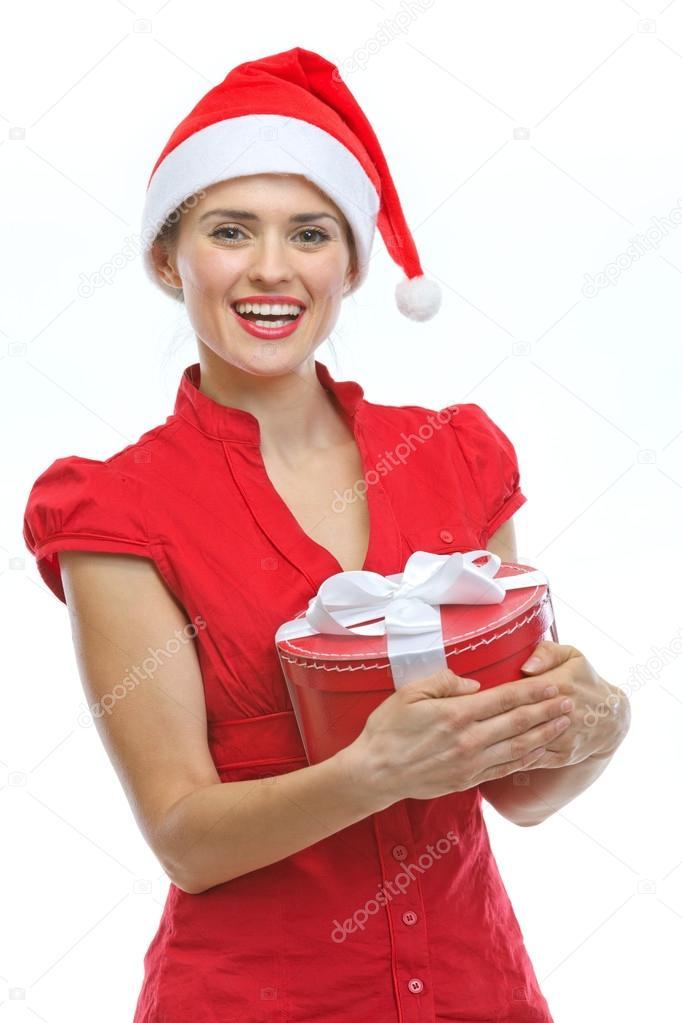 Happy young woman in Santa hat with Christmas present box — Stock Photo #13728524