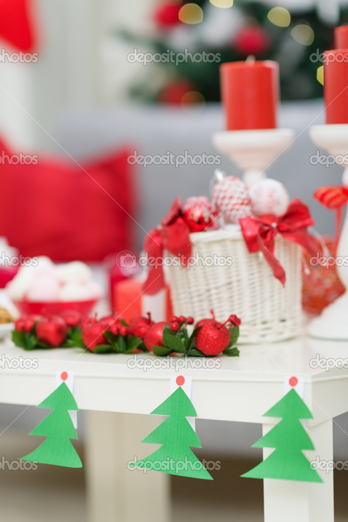 Closeup on table with Christmas decorations — Stock Photo #13729176