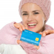 Closeup on credit card in hand of woman in winter clothing — Stock Photo #14919867