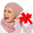 Happy woman in knit winter clothing shaking Christmas present bo — Stock Photo