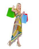 Smiling girl in dress with shopping bags — Stock Photo