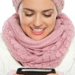 Happy woman in knit winter clothing writing text message — Stock Photo #14920291