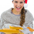 Happy woman in Santa hat holding pack of Christmas letters — Stock Photo #14921495