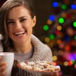 Happy woman holding cup of hot chocolate with marshmallows and p — Stock Photo #14924225
