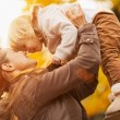 Young mother rising baby up — Stock Photo #14925541