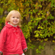 Stock Photo: Portrait of happy baby in red coat outdoors