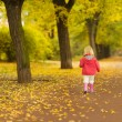 Baby running in park. Rear view — Foto Stock