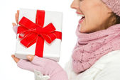 Closeup on Christmas present box in hand of woman in winter clot — Stock Photo