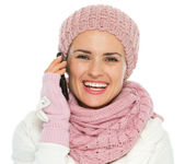 Happy woman in knit winter clothing making phone call — Stock Photo