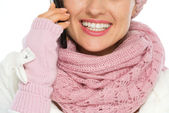 Closeup on happy woman in winter clothing speaking mobile — Stock Photo