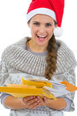 Happy woman in Santa hat holding pack of Christmas letters — Stock Photo